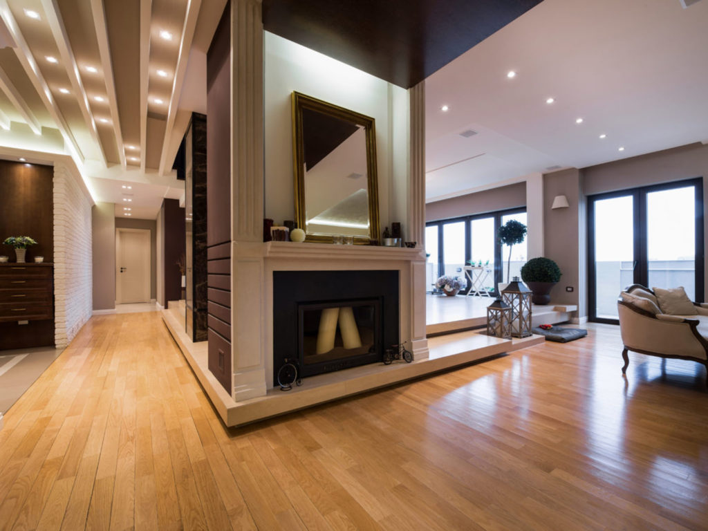 Luxury apartment interior with fireplace filed with candles